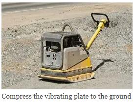 Compress the vibrating plate to the ground
